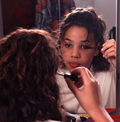 young child wearing makeup