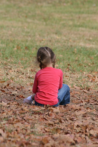 young girl sitting quietly